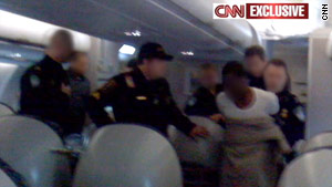 Officers take suspect into custody in Detroit, Michigan, after an attempt to destroy a Northwest Airlines flight.
