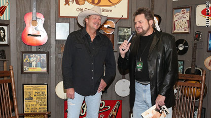 Alan Jackson (left) sizes up the store full of his paraphernalia.